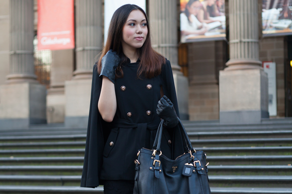 Cape, Jacket, Black, Shift dress, Prada tote, Pumps, Gloves